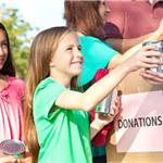 Image: Young children handing out canned food donations