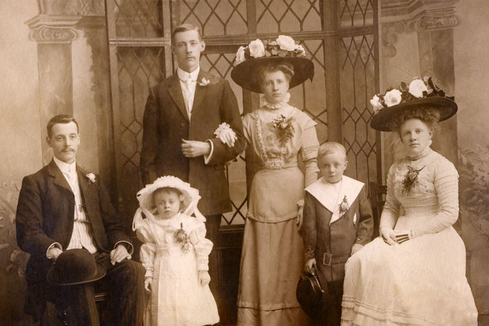 historic sepia tone photo of family in the early 1900s