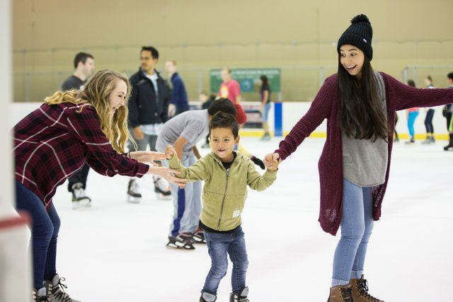 skaters on an indoor ice rink