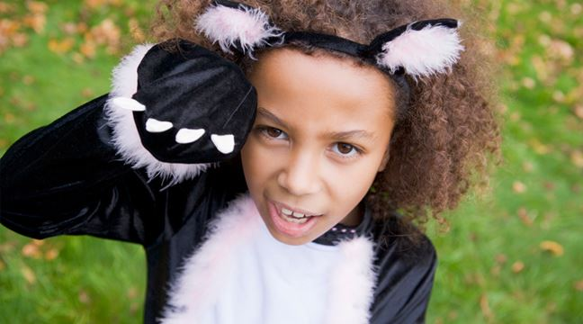 Young girl dressed in Halloween costume
