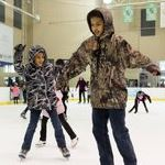 two children ice skating