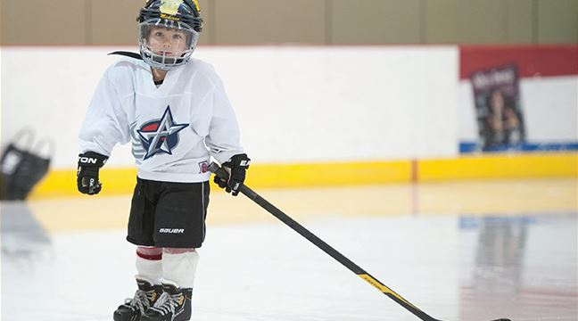 Young child wearing hockey gear